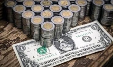 Escala dólar a $19.85 por reforma de EU